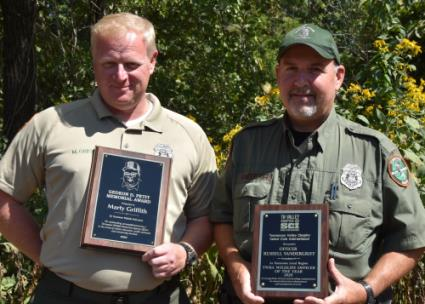 Marion County Wildlife officers, Officer Marty Griffith on left, and Officer Russell Vandergriff, received awards reflecting their dedication to service within their community and beyond