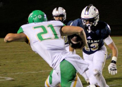 Rhea County's Dalton Hampton looks to get past Soddy Daisy's Rhett Stottlemire.