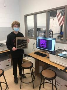 Cash Keene, a student at Signal Mountain Middle/High School with his laser-cut image produced in the eLab