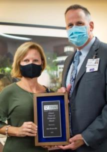 Erlanger President and CEO Dr. William Jackson presents Janet Kramer-Mai with the THA Nurse of Distinction Award