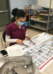 Curtaelyn Martin, an 11th grader at The Howard School, working in the Erlanger Institute of Healthcare and Innovation Sterile Processing pathway