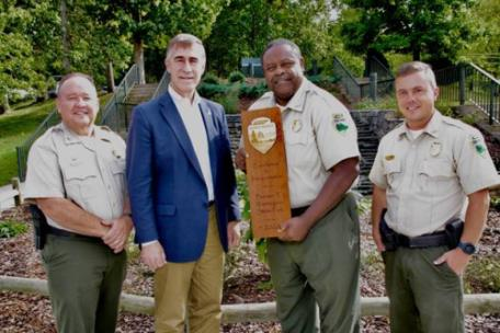 From left are Mike Robertson, director of parks operations; Jim Bryson, deputy commissioner of the Tennessee Department of Environment and Conservation; Levan Gardner, park manager; and Kenny Gregg, area manager