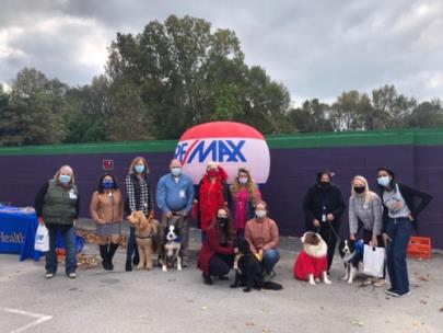 Carol Potts and Becky Smith, RE/MAX realtors, were in costume and donated hand sanitizer and personal supplies to prevent COVID-19