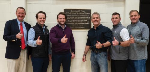 Former Bradley Bears Wrestling Coach Steve Logsdon was honored with a special plaque from the Allan Jones Foundation in the Jim Smiddy Arena at Bradley Central High School this week. Pictured from left: Toby Pendergrass (Allan Jones Foundation), Will Jones (Vice President of Check Into Cash and Jones Properties), J. Bailey Jones (Vice President at Check Into Cash), Steve Logsdon, Bradley Principal Patrick Spangler, and Bradley Athletic Director Turner Jackson.