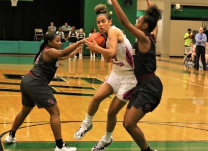 East Hamilton's Madison Hayes, center, splits the Oak Ridge defense on her way to the basket in a game played Thursday night in  the Lady Hurricanes' gymnasium. Hayes had 28 points to lead East Hamilton past the Lady Wildcats, 63-61.