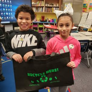 Dante Tugwell and Yuvitsel Calderon from Mrs. Ana Goodlett's third grade class at Roan Elementary with one of the classroom recycling bags