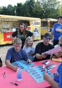 Tennessee Racers signing autographs at Tazewell Speedway Grandstands