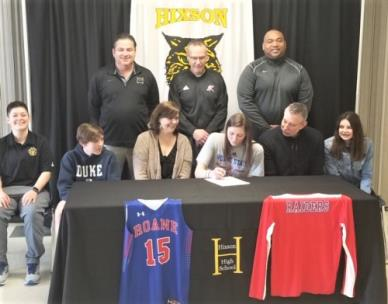 Hixson's Kirby Brown recently signed to play basketball with Roane state Community College. Pictured at her signing are, front row (L_R) Emilie Sloan, Hixson Assistant Coach; Chapman Brown, brother; mother Tricia Brown; Kirby Brown;, Steve Brown,  father; and,  sister Eddy Brown). Back Row (L-R) Tommy Swanson, Hixson Head Coach; David Harnish, Roane State Head Coach; and,  Roy Pankey, AAU Coach.