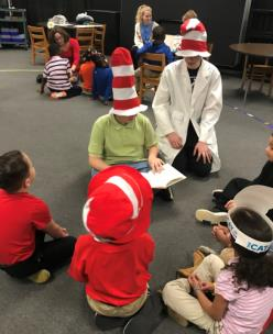 Pictured, left to right, Derrick Webber and Will Denton, members of the Center of Creative Arts National Junior Honors Society, read to students during the Seuss on the Loose project