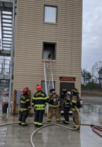 Cleveland firefighters participating in a search and rescue training course as part of the CFD's Rookie School, where Lee students assisted with assessment to ensure the firefighters' health and safety