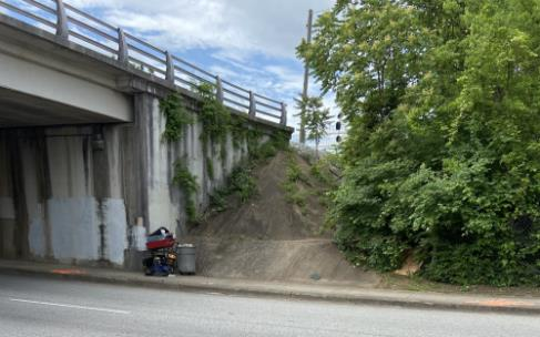 Entrance to homeless encampment off Main Street at railroad overpass