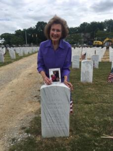 Lounelle at Glenn's grave at the National Cemetery
