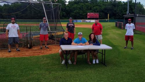Jacob Robinson, seated front center, has signed to play baseball at Cleveland State. Flanking the former Ooltewah infielder/pitcher are his parents, Jason and Shannon. In the back are, left to right, , Ooltewah assistant coach Tyson Latham, head coach Brian Hitchcock, assistant Wes Caldwell, Blake Wachveitl and Corey Rhinehart. 