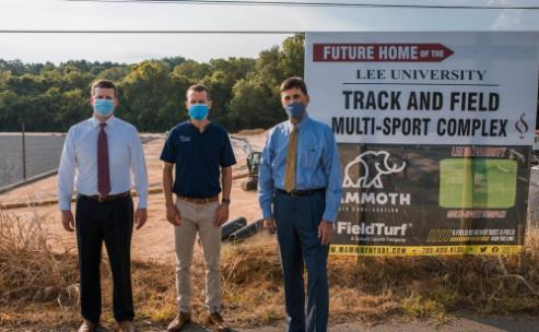 From left, Cole Strong, Coach Caleb Morgan, and Dr. Paul Conn at the site of Lee's Multi-Sport Complex on Parker Street