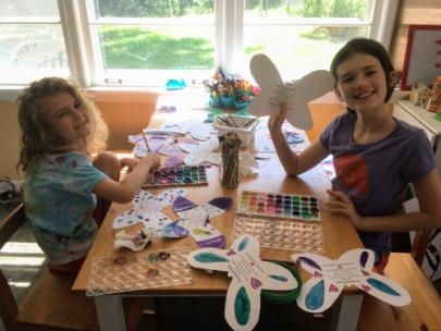 Avery and Phoebe Gilligan painting some of the butterfly door-hangers that they donated to Morning Pointe of East Hamilton