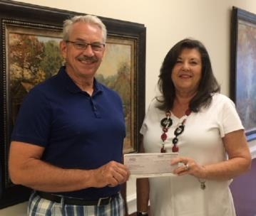 Shirley Smith (right) of the Smith Charitable Endowment presents a check to Tony Hullender, president of the Habitat for Humanity of Catoosa County