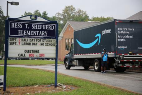 Amazon driver Stephen Bailey arrives at Bess T. Shepherd in the Amazon Prime truck