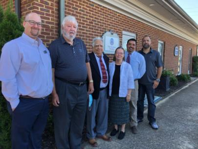 Shown from left are Michael Reed, (SimplyBank), Richard Buhrman (Buhrman Law Firm), Sushan Anand, Cathy Anand, Anil Anand and Josh Anand