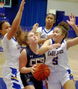 CCS's Lily Brady tries to get a shot off in the lane under alot of pressure.
