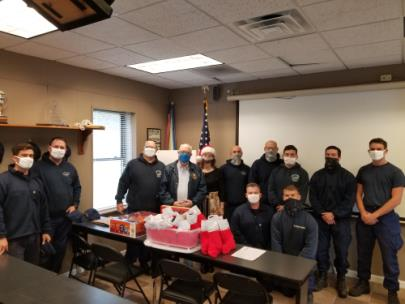 Coast Guard Ouachita Station crew members with David Smith and Stacy Kehoe