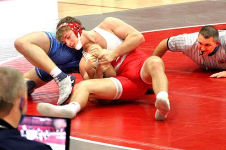 Baylor's David Harper works for a pin of McCallie's Harrison Millirons