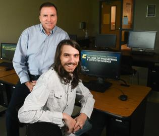 Greg Jones and Mitchell Jones, father and son, are graduating exactly 40 years apart and earning the same degree, a bachelor's degree in computer science from UTC